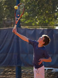 Tennis match. Young boy in tennis match ball hitting wing Stock Image