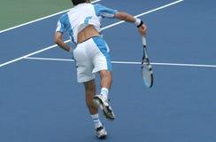 Tennis: Nach dem Serve Stockfotos