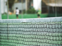 Tennis net. Close in on tennis net, green court Royalty Free Stock Photos