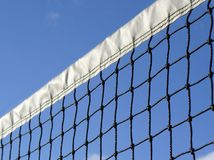 Tennis Net. Looking up at a tennis net from a low angle on a blue sky summer day Stock Images