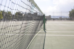 Tennis Net. On the tennis court outside during the day Royalty Free Stock Photo