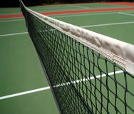 Tennis Net. With court in the background stock images