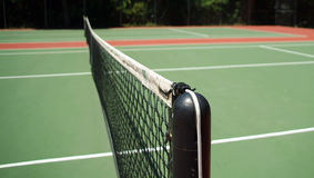 Tennis Net. With court in the background Royalty Free Stock Photo