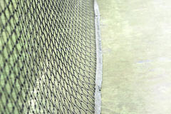 Tennis net background. Net on green  court sport background Royalty Free Stock Image