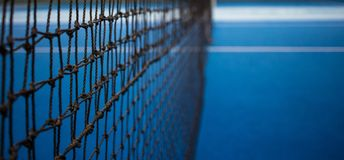 Tennis net and blue court. stock image