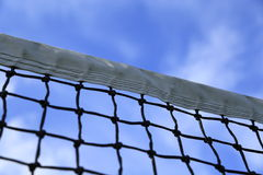 Tennis net and blue sky as background Royalty Free Stock Photos