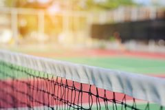 Tennis net on court background. Tennis net on blur court and abstract background Royalty Free Stock Images