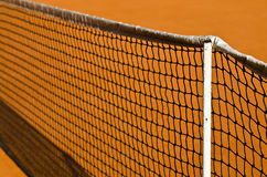 Tennis net and clay. Photo of a tennis net and clay Royalty Free Stock Photo
