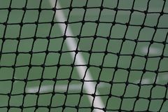 Tennis net on court background. Tennis net on blur court and abstract background Royalty Free Stock Photography