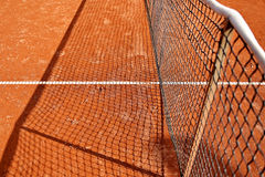 Tennis net detail on clay court Royalty Free Stock Photography