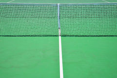 Tennis net in green court Stock Images