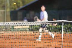 Tennis net Man plays tennis Royalty Free Stock Photos