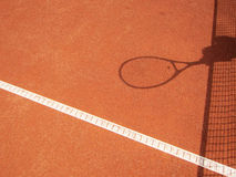 Tennis net and racket shadow (63). Tennis net and racket shadow, outside in a tennis court Stock Photos