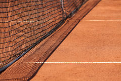 Tennis net & red ground Stock Images