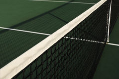 Tennis Net's Shadow. Tennis net and it's shadow upon the court Stock Photography