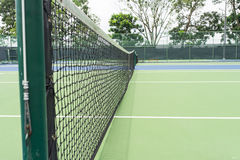 Tennis Net. Tightened tennis net on pole at tennis court Royalty Free Stock Photos