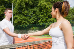 Tennis opponents shaking hands before match. On a sunny day Stock Photography