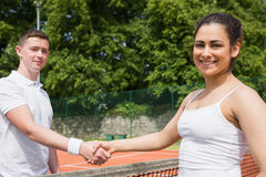 Tennis opponents shaking hands before match. On a sunny day Royalty Free Stock Images