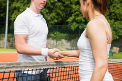 Tennis opponents shaking hands before match. On a sunny day Royalty Free Stock Image