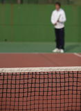 Tennis player. Waiting for the serve of his Royalty Free Stock Photos
