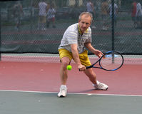 Tennis player. Middleage man playing tennis Royalty Free Stock Photo