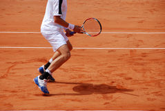 Tennis player. In action on a tennis field Stock Photography