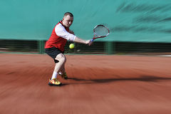 Tennis Player. Hitting Slice Backhand on Clay Court Stock Images