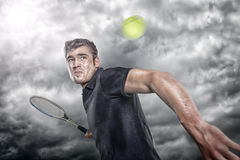 Tennis player. In front of dramatic sky Royalty Free Stock Photography
