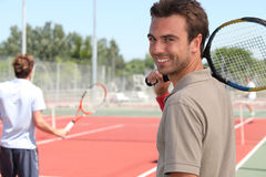 Tennis player. A tennis player is smiling Royalty Free Stock Photos