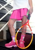 Tennis player. Wearing pink skirt, holding a tennis raclet royalty free stock images
