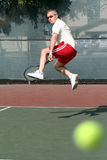 Tennis player. Middleage man playing tennis Stock Photography