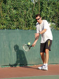 Tennis player. Serving the ball Royalty Free Stock Image