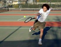 Tennis player. Teenage boy playing tennis Stock Image
