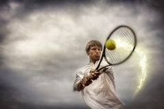 Tennis player. In action on cloudy background Stock Photo