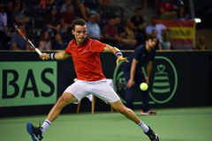 Tennis player in action. CLUJ NAPOCA, ROMANIA - JULY 16, 2016: Spanish tennis player Roberto Bautista playing during a match Davis Cup by BNP Paribas match Stock Photo