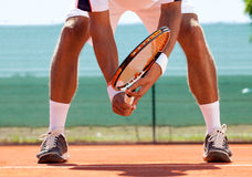 Tennis player in action. Tennis court from low angle with Tennis player in action Royalty Free Stock Photos