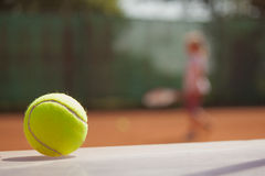 Tennis player in action on court Royalty Free Stock Photography