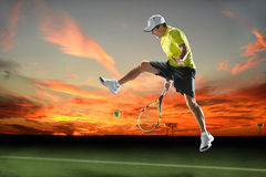 Tennis Player in Action at Sunset Royalty Free Stock Photos
