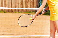 Tennis player with ball and racket on a clay court Royalty Free Stock Images