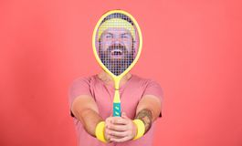 Tennis player beginner retro fashion. Tennis sport and entertainment. Concentrated on tennis court. Athlete hipster hold. Tennis racket in hand red background stock image