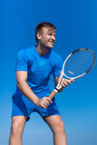 Tennis player in blue tennis sportswear posing against clear sky Stock Images