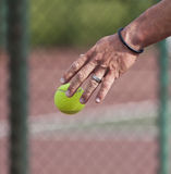 Tennis player bouncing  ball on court Royalty Free Stock Photo