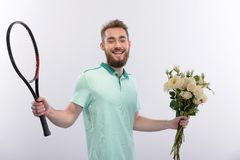 Tennis player with bouquet of flowers Stock Photography