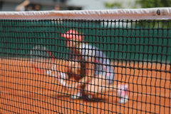 Tennis player at clay court during doubles match Royalty Free Stock Image
