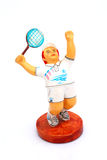 Tennis Player Clay Figurine. Chubby male tennis player depicted as a painted clay figure Stock Photos