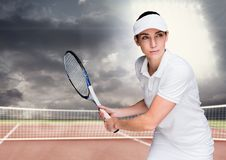 Tennis player on court with bright light and dark clouds stock images
