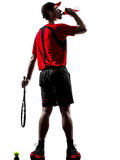 Tennis player drinking energy drinks silhouette Stock Photo