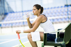 Tennis player drinking water Stock Photography