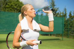 Tennis player drinking water Royalty Free Stock Photo