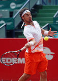 Tennis player effort. Italian player Fabio Fognini pictured in action during his game against Marcos Baghdatis counting for Romanian BRD Nastase-Tiriac Trophy Stock Image